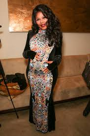 The Buzz... Lil Kim baby bump